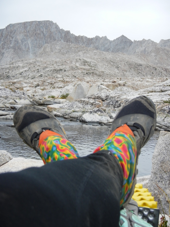 Dirty Girl gaiters, New Balance Minimus trail runners, and wool leggings.