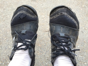 Close-up of Babz's feet-saving shoes: New Balance Minimus trail runners. they're a discarded pair of mine that she brought to use  as water shoes and around-camp wear. Now they are REALLY worn out!