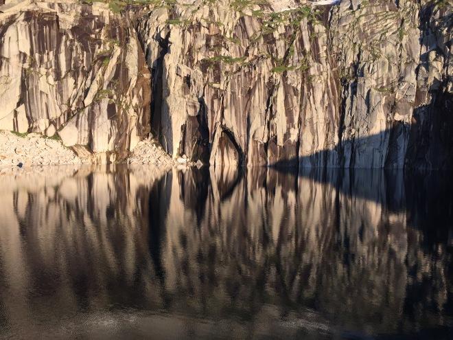 The sun hits the cliffs of Precipice.